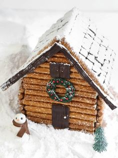 Use pretzel rods to craft up a rustic log cabin gingerbread house to serve as the centerpiece for a holiday dessert table or mantelscape. Get the step-by-step instructions. Gingerbread House Parties, Christmas Gingerbread House, Noel Christmas, Christmas Goodies, Christmas Baking, Winter Christmas, Xmas, Gingerbread Houses, Christmas Ideas