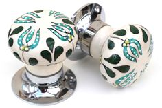 This is Knobbles and Bobbles pair of pretty green embossed ceramic mortice knobs with a green and turquoise floral pattern The diameter of these