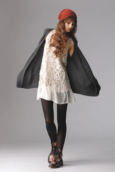 Fall 2012 Trend: Nevermind (Again)    (Alternative Apparel's cotton cardigan and Black Sheep's cotton crochet and silk dress. Krochet Kids beanie; Hue tights; Dr. Martens boots.)
