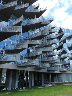 This building, located in Copenhagen, Denmark was designed by PLOT, BIG – Bjarke Ingels Group, JDS architects. Unique Buildings, Interesting Buildings, Amazing Buildings, Futuristic Architecture, Contemporary Architecture, Art And Architecture, Architecture Student, Big Building, Building Design