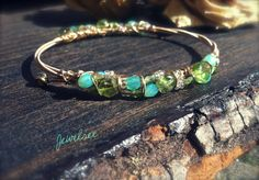 Peridot and Glass Beaded GUITAR String Bangle.