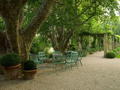 love the color of the wrought iron furniture rough luxe: The Enchanting Gardens of Dominique Lafourcade
