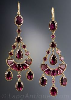 Antique Chandelier Garnet Earrings, Simply stunning, early-Victorian (maybe Georgian), almost 2 1/2 inches long drop earrings glistening with a multiplicity of multi-shaped, rich raspberry colored garnets, lovingly hand crafted and backed in 14K yellow gold. Rare, ravishing and romantic. 2 3/8 inches long and ust over 7/8 inch at the widest points. The earwires were added at a later date.: