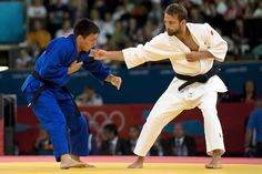 Nabor Castillo of Mexico (blue) vs. Elio Verde of Italy, during the London 2012 Olympic Games