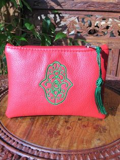 Moroccan leather purse in red. http://www.maroque.co.uk/showitem.aspx?id=ENT06416&p=01571&n=all