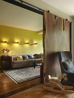 Walnut Slab door - LOVE..  Studio Geiger Contemporary Living Room with Live Edge Walnut Slab Door, Remodelista