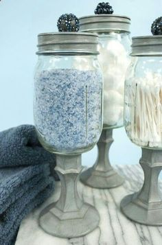 get some glass $1. store candle sticks and put your mason jar on top and add a bead or knob to the top after you spray paint them...Love it for the bathroom!