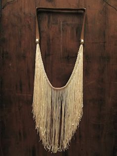 Runaway Thrift: DIY Fringe Studded Leather Necklace (NOTE TO SELF: Use basic idea to make into more of a Native American art piece.)