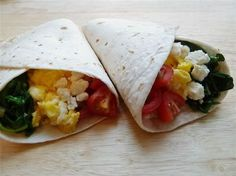 Breakfast burritos with spinach, tomatoes and Feta