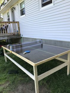 Diy ping pong table(used the Kreg jig for the legs, has braces across the top/under table top. table top plywood stained with trim, poly urethaned. Outdoor Table Tennis Table, Outdoor Tables, Outdoor Ideas, Diy Dining Room Table, Diy Table, Ping Pong Table Diy, Ping Pong Room, Ping Pong Games, Diy Yard Games