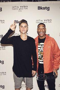 Justin Bieber wearing  Onemeth Jersey Long, Fear of God Dropcrotch Drawstring Shorts, LMDN Camo Trucker Cap