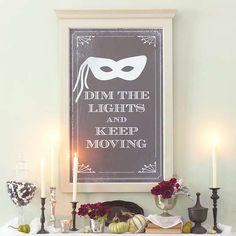 Posters are an easy and inexpensive way to decorate to theme. Here, a poster reciting an old Creole expression is taped over a mirror. Print our downloadable banner (available below) to the desired size, and temporarily attach it to a mirror using double-sided tape, or place it in a frame.
