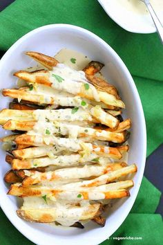 Baked Fries with Garlic Tahini Lemon Sauce - Russet potato baked and drenched in garlic tahini hummus lemon sauce | VeganRicha.com