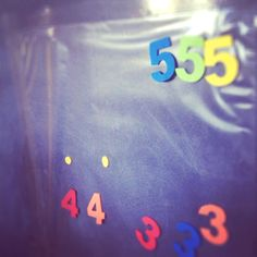 Number sorting using 'contact' (sticky backed plastic) attached sticky-side-out to the wall