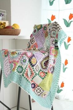 Picture only - great mix of colors in this granny square crocheted throw.