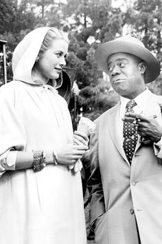Grace Kelly and Louis Armstrong on the set of High Society, 1956.