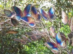 copper art depicting blue butterflies in flight at Arlie Gardens in Wilmington, North Carolina