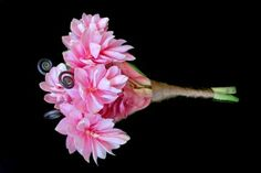 Love this, it's pink ginger lily bouquet which is a local Jamaican flower so it's really affordable.