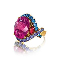 Verdura Rubellite, Sapphire and Ruby Ring One 13 carat faceted oval rubellite, 28 faceted round blue and purple sapphires, and two faceted B...