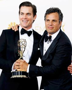 """Matt Bomer and Mark Ruffalo pose with their Outstanding Television Movie award for HBO's """"The Normal Heart"""" at the 66th Primetime Emmy Awards in Los Angeles, California August 25, 2014"""