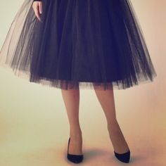 "NWOT BLACK TULLE SKIRT NWOT BLACK TULLE SKIRT. Says large, fits like medium. 27"" length. Elastic waist. Stretches out to 33"". Skirts A-Line or Full"