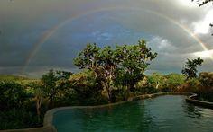 Rainbow over pool at Galapagos Safari Camp, Santa Cruz Island, Galapagos Islands, Ecuador