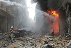 Syrian emergency personnel extinguish a fire following a reported air strike by Syrian government forces on March 7 during the Friday prayer in the Sukkari neighborhood of the northern city of Aleppo. More than 140,000 people have been killed in Syria since the start of a March 2011 uprising against the Assad family's 40-year rule. (Baraa al-Halabi/AFP/Getty Images)