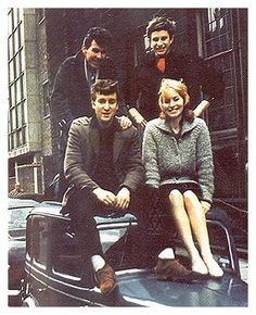 THE SOURCE - The Savage Young Beatles - Circa 1959 - Liverpool  In her book John, Cynthia Lennon says these photos taken in 1959 in Liverpool. The friends are Tony Carricker and John Hague, their collegues in Liverpool Art College. Cynthia is obviously correct and we can verify this. John Hague was the painter that John helped in 1968 in a gallery exibition. According to Cynthia, the car belongs to Hague's mother.