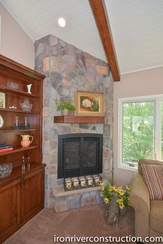 Stone fireplace in porch remodel