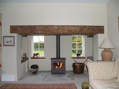 Renovated Essex inglenook with clad reclaimed oak beam, sand stone hearth and Clearview vision 500 wood burning stove installation in Fyfield by Scarlett @ Design a fireplace 2008 Fireplace Beam, Log Burner Fireplace, Cottage Fireplace, Inglenook Fireplace, Wood Burner, Fireplace Design, Fireplaces, Stove Installation, Earthy Home