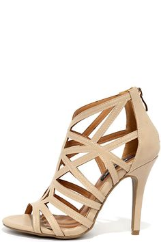 With a chic, geometric network of vegan leather straps, the So Fine Nude Caged Heels are lookin' H-O-T! Peep-toe upper includes a zippered heel cup with gold pull.