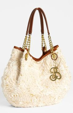 Betsey Johnson Rose Garden Tote: Goldtone hardware, slouchy tote overlaid with gauzy flowers.