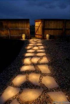 Spray glow paint on stepping stones for a walk way!