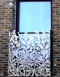 you could buy one of those cheap blinds and cut a design like this into it..cool shadows it would create. laser cut screens - Google Search