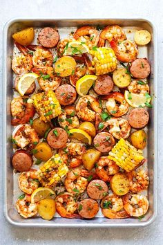 Shrimp boil on a sheet pan, ready to serve. Shrimp Boil In Oven, Shrimp Boil Party, Cajun Seafood Boil, Cajun Shrimp Recipes, Seafood Boil Recipes, Boiling Crab Cajun Shrimp Recipe, Cajun Butter Recipe, Shrimp Boil Seasoning Recipe, Shrimp Boil Recipe Old Bay