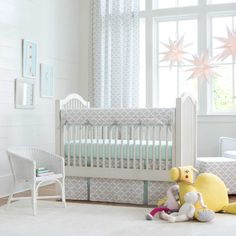 French Gray and Mint Quatrefoil Crib Bedding | Carousel Designs. You can't go wrong with this modern quatrefoil crib bedding collection. It features a soft French Gray and is accented with our Icey Mint. The plush minky adds a touch of elegance for your nursery, not to mention it's the perfect gender neutral bedding.