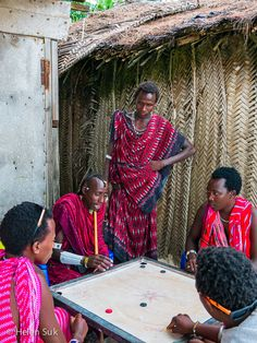 Masai shopkeepers break for games on the beach. Click to see more of my favourite images of island life in Zanzibar, Tanzania.