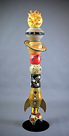Space travel ceramic totem pole, $2,300