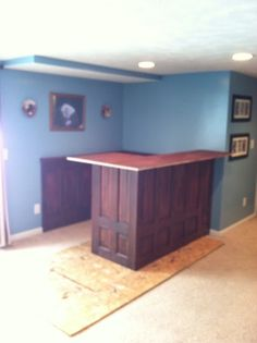 Cool ManCaves - Roxanne Recycles: How to build a Home Bar on a budget. We have plenty of those doors we can use! Basement Bar Plans, Basement Bar Designs, Basement Remodel Diy, Basement Remodeling, Remodeling Ideas, Basement Ideas, Basement Decorating, Basement Bars, Basement Ceilings