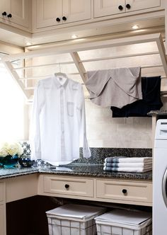 Cabinet color, under-cabinet lights, granite color Traditional Laundry Room by Jane Lockhart Interior Design