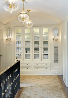 Beautiful hallway linen storage - this could be done in between studs and add doors or some sort of sliding door feature