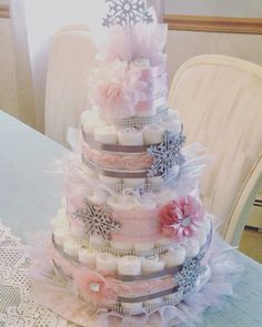 One of my favorites! Pastel pink and silver diaper cake! Baby it's cold outside theme