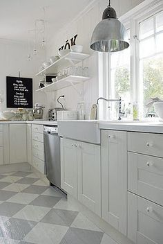 white/gray industrial meets cottage kitchen  diamond painted floor, farm sink windows