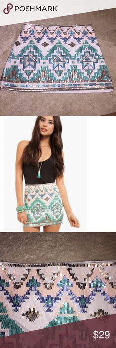 Sequin Tribal print Mini skirt Features sequin details all around.    *Shell: 95% Polyester, 5% Spandex; Lining: 100% Polyester *Hand wash cold Verty Skirts Mini