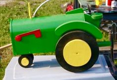 Tractor mailbox is a great gift! Mailboxes are USPO approved. The mailboxes are handcrafted and hand painted. Special mailboxes can be made for you. They are created and crafted by the talented artist Michel Devost in Quebec, Canada. For more information and orders contact Michel at:  http://pages.globetrotter.net/miche/mailboxes.html