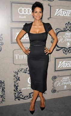 Roland Mouret. My FAVORITE dresses. He knows how to flatter a woman's body.