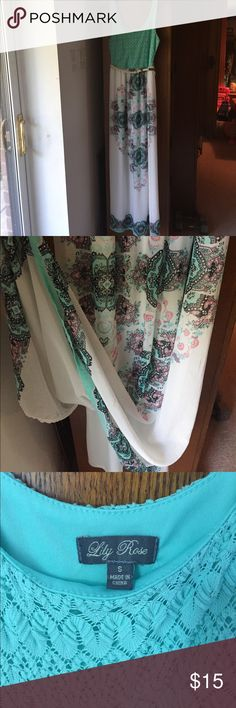 Gorgeous Maxi Dress A sea foam green top with paisley like designs on the bottom. Bottom part is sheer with a white attached slip underneath (pictured). Only worn once or twice. Still love this dress it's just too small for me now. Lilly Rose Dresses Maxi