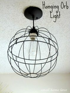 DIY Industrial Hanging Orb Light - from hanging baskets Hanging Flower Baskets, Diy Hanging, Hanging Wire, Wire Chandelier, Pendant Lighting, Chandeliers, Basket Lighting, Lighting Ideas, Orb Light