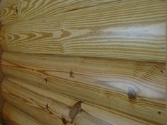How cool would it be to have a wall done in this? Southern Pine log siding with clear coat for interior use. Heart Pine Flooring, Pine Floors, Wide Plank Flooring, Engineered Hardwood Flooring, Pecky Cypress Paneling, Log Cabin Siding, Log Wall, Installing Hardwood Floors, Log Home Plans