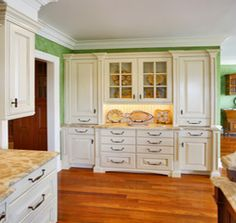 White cabinets with  bead board back splash and marble tops